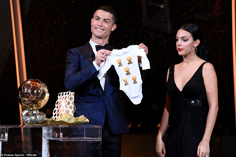 Cristiano Ronaldo and his stunning girlfriend Georgia Rodriguez pose with his fifth Ballon d