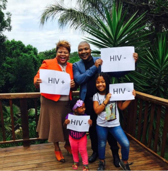 Viral photo of a HIV positive woman with her HIV negative husband and kids