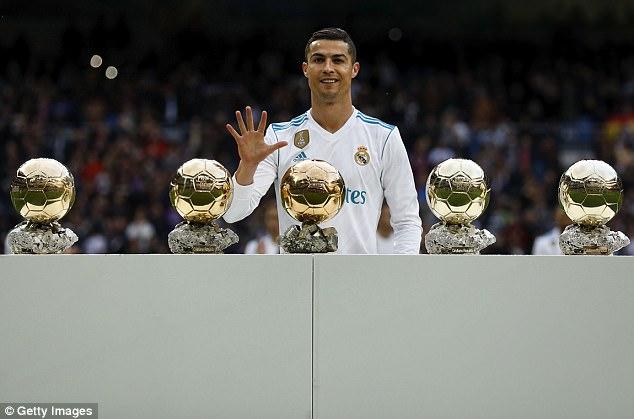 Cristiano Ronaldo poses with his five Ballon d