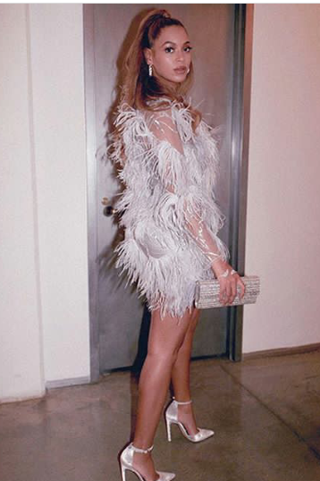 Beyonce sparkles in head-to-toe silver and avant garde jewelry
