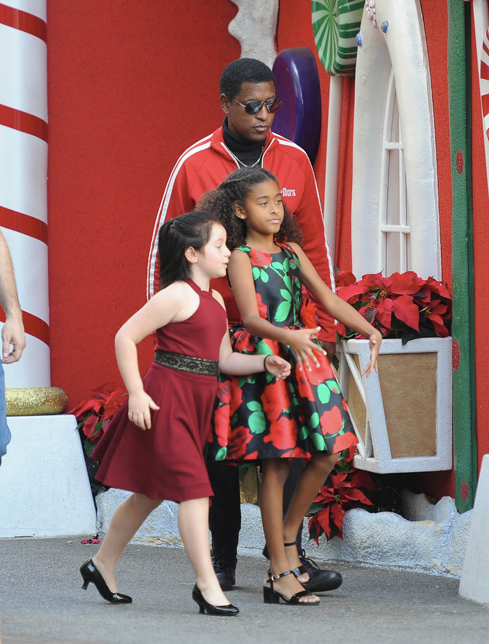 Singer Babyface and family get into the Christmas mood as they visit Santa Claus together (Photos)