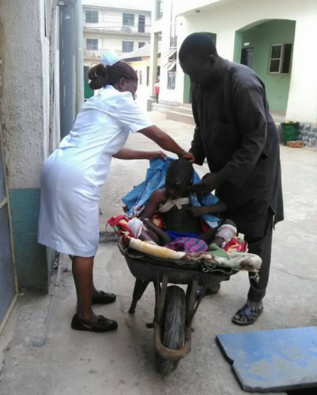 Man takes son to hospital in a wheelbarrow due to transportation problems in Imo state