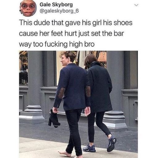 Cute photo of a man walking barefoot because he gave his shoe to his lady whose heels was hurting her