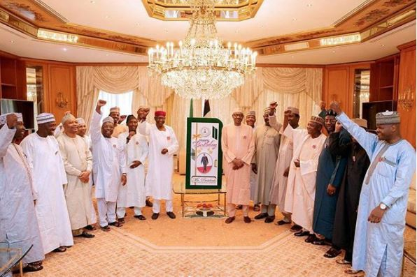 Photos: President Buhari receives birthday card from his grand daughter, governors and aides