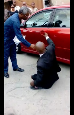 Photos: House of Reps member, Femi Gbajabiamila, gives a car to physically challenged lawyer