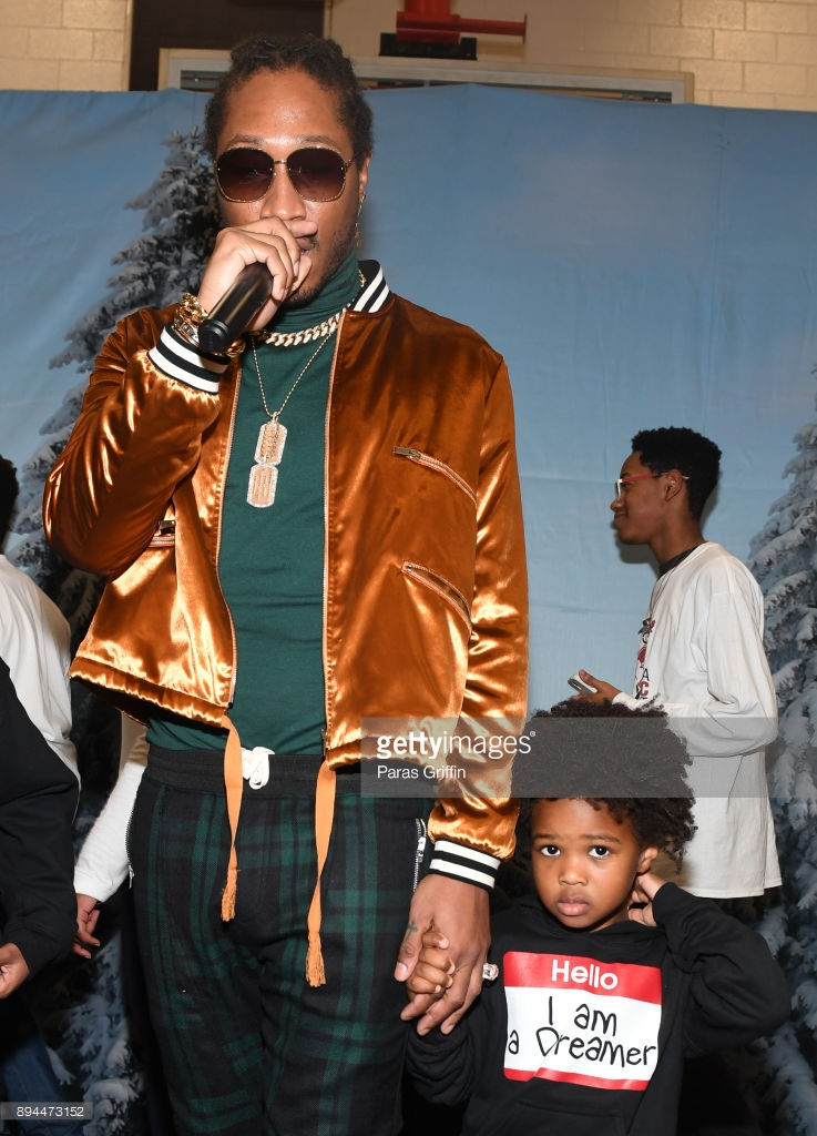 Daddy duties! Future steps out with his four children for an event (Photos)
