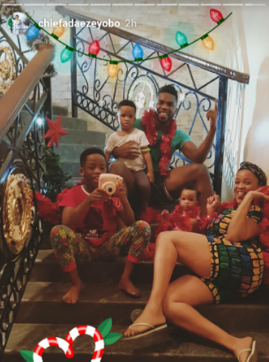 Joseph & Adaeze Yobo all smiles as they pose for a family photo at home with their kids