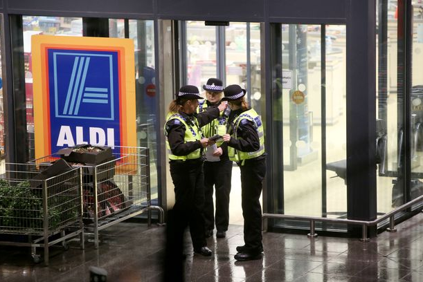 Woman dies after being stabbed at Aldi supermarket before brave Christmas shoppers pinned knifeman down