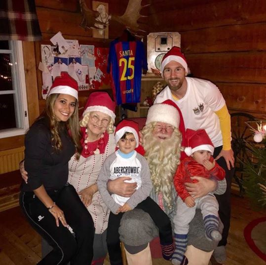 Lionel Messi shares adorable Christmas photo with his family as they pose with Santa Claus