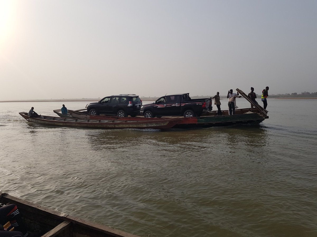 Photos: Absence of a bridge forces Sokoto state governor, Aminu Tambuwal, to be ferried inside his car across River Benue