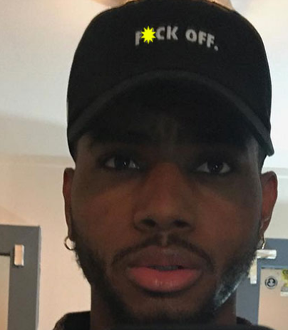 Photo purportedly shows R&B singer Bryson Tiller kissing rapper NAV while sitting on his lap