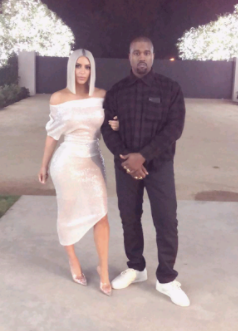Kim Kardashian and Kanye West ring in the New Year with a kiss in front of family & friends