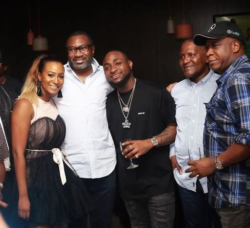 A very expensive photo featuring Davido, Femi Otedola and Aliko Dangote