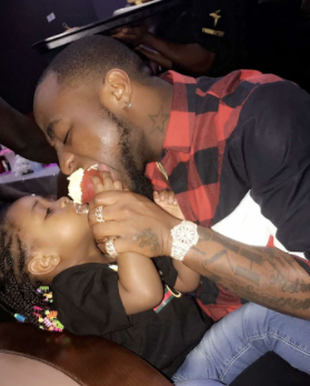 Adorable photo of Davido & his daughter, Imade sharing a cupcake at a birthday party