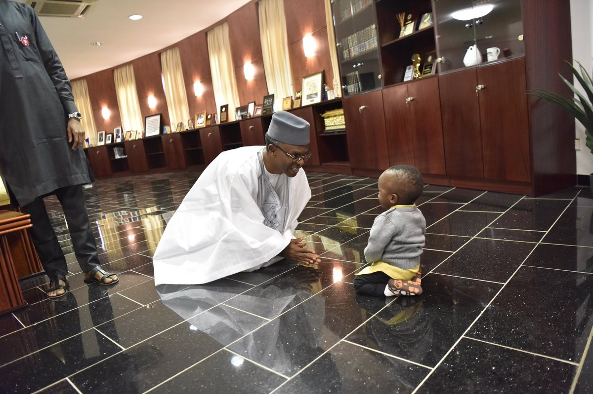 Adorable photos of Governor Nasir El-Rufai and a little boy who paid him a visit in his office today