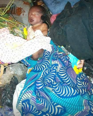 Newborn baby found dumped inside a dustbin at the center of a road in Port Harcourt (graphic photos)