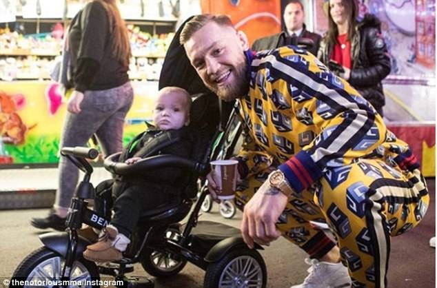 Conor McGregor wears ?1,785 Gucci tracksuit for special outing with his family and friends (Photos)