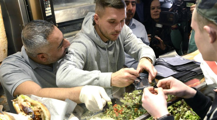 Ex-Arsenal star Lukas Podolski becomes a Shawarma seller in his home country Germany (Photos)