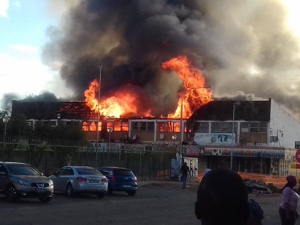 Photos/Video: Four Nigerians in critical condition after serious attacks from South Africans, their shops burnt