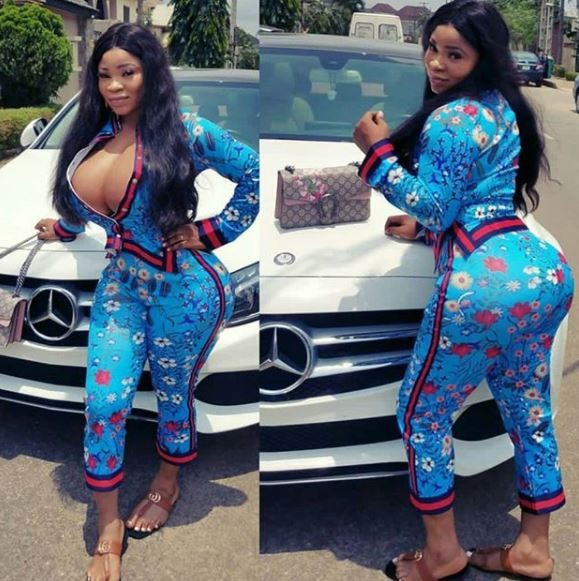 Roman goddess and her?massive boobs step out in the famous?N1.1m Gucci floral print pyjamas