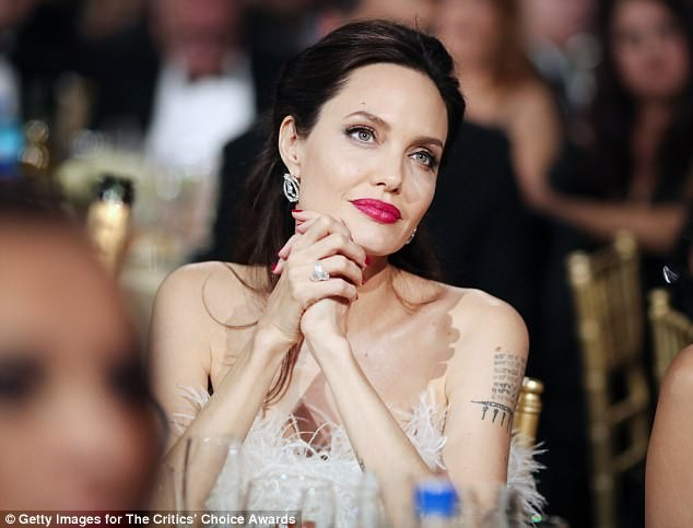 Angelina denies dating Cambodian filmmaker, PraCh Ly, says she won