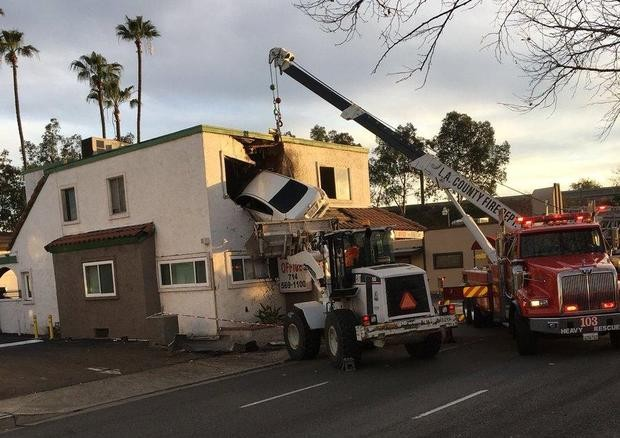Speeding car flies and crashes into second floor of California building, occupants miraculously survive