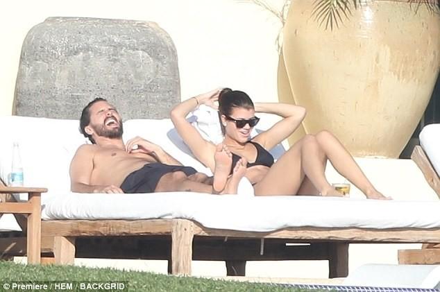 Bikini-clad Sofia Richie gets cozy with her boyfriend Scott Disick on a beach in Mexico (Photos)