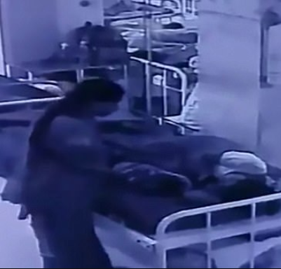 Chilling moment a woman snatches a newborn baby as he slept beside his mother in a hospital maternity ward (video)
