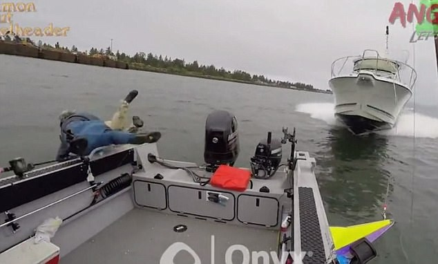 Watch the terrifying moment fishermen dive into river to avoid huge speedboat from killing them
