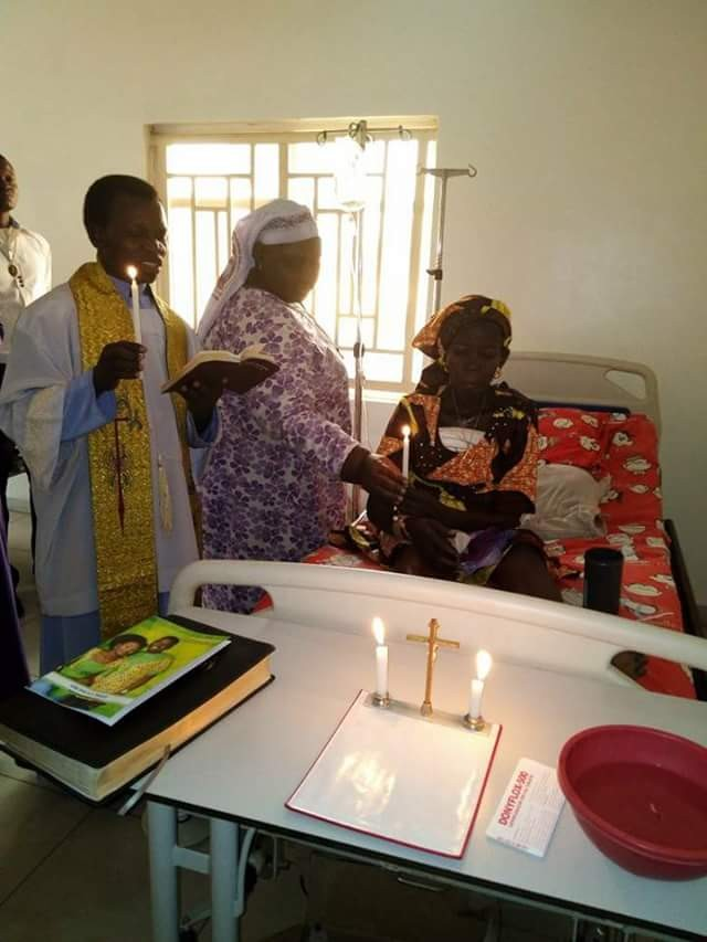 Photos: 50 years after, man weds his wife battling with breast cancer on her hospital bed in Benue State