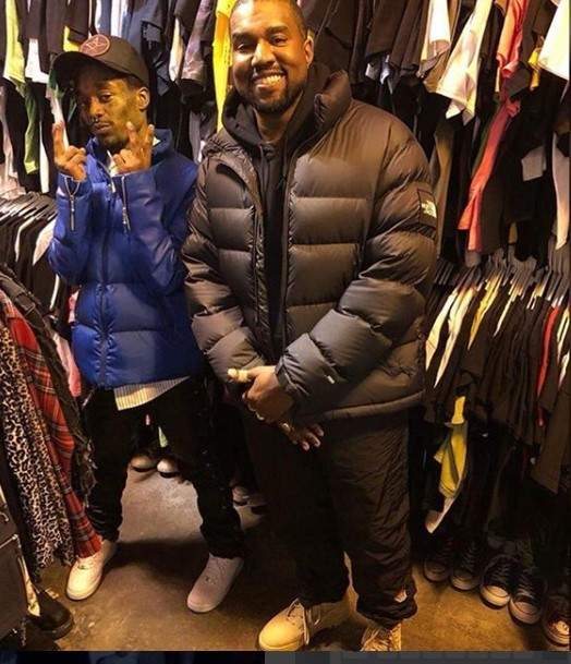 Kanye West and Lil Uzivert seen posing in a clothing store