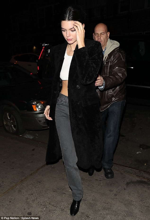 Braless Bella Hadid steps out in daring see-through top as she dines with pals Kendall Jenner and Hailey Baldwin in NYC (Photos)