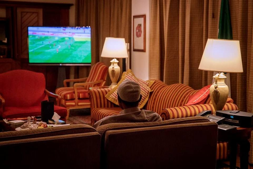 Photos of President Buhari watching the Super Eagles match against Angola