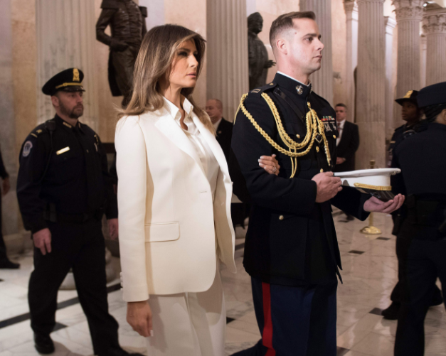 First lady,?Melania Trump rocks white pantsuit to her husband