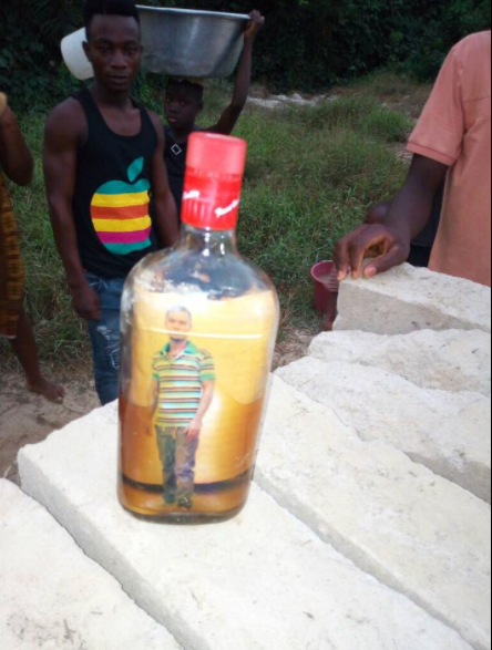 A picture of a man and crucifix inside a bottle washes ashore at Bonsa river, Ghana