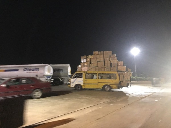 Overloaded bus with multiple cartons of goods spotted on Lagos road (Photos)