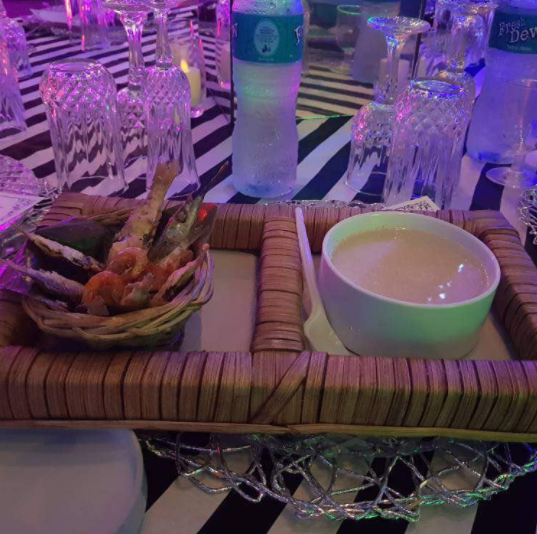 Ijebu garri and fried fish served as refreshment at a wedding reception