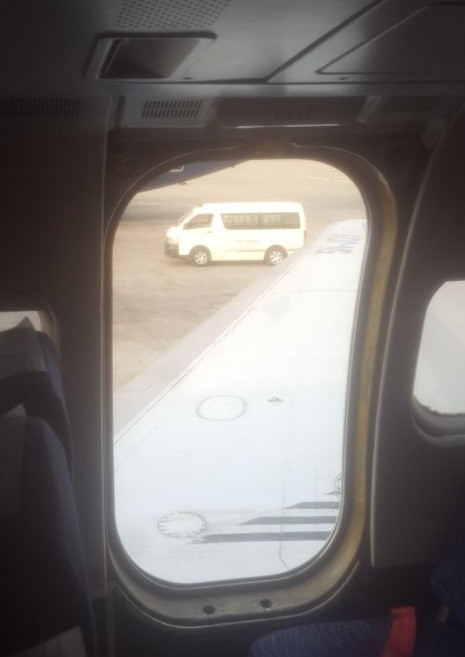 Passengers in shock as exit door of a Dana Airline plane falls off as it landed at an airport (photos)