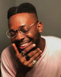 Between Adekunle Gold and Simi after he debuted his new look
