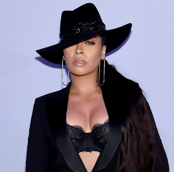 Lala Anthony stuns at New York Fashion Week in lingerie tuxedo