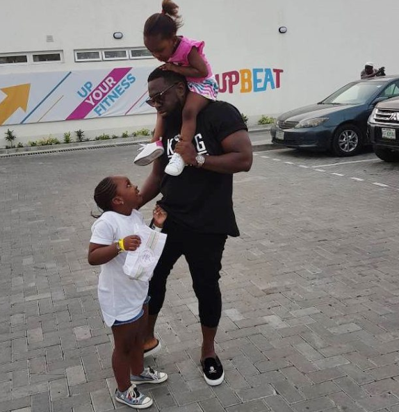 Timaya spends quality time with his daughters
