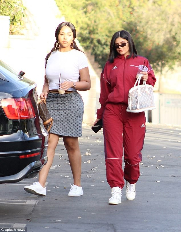 New mom Kylie Jenner steps out in LA dressed in a burgundy Adidas track suit (photos)