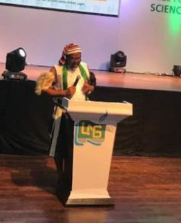 Nigerian Writer, Ikeogu Oke who won the NLNG prize for literature rocks a traditional Ohafia wrestler attire to the award ceremony