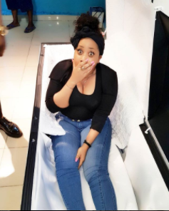 "Actress, Moyo Lawal takes a picture inside a coffin, tags it ""mortuary selfie'"