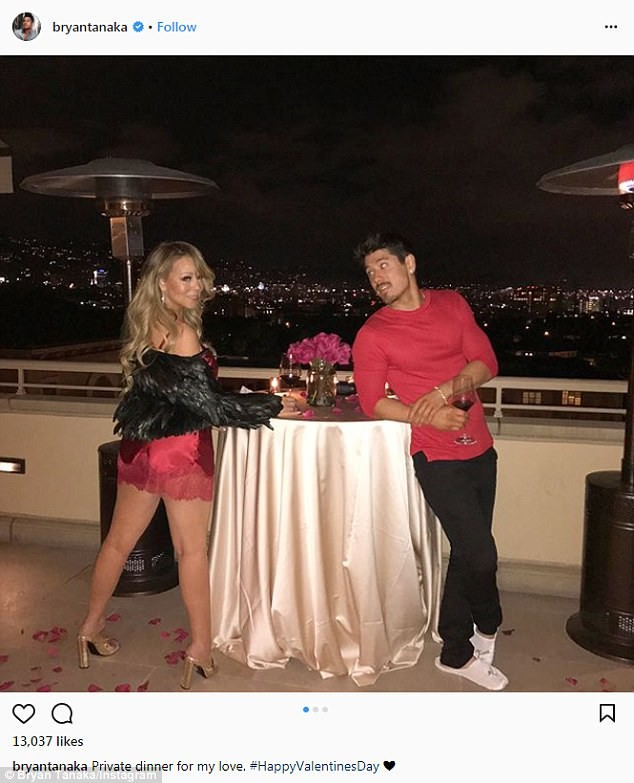 Sexy photo of Mariah Carey in candy bra as she poses with her shirtless beau Bryan Tanaka on Val