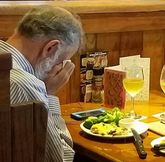 Heartbreaking photo of man dinning alone with wife's ashes on Valentine's Day