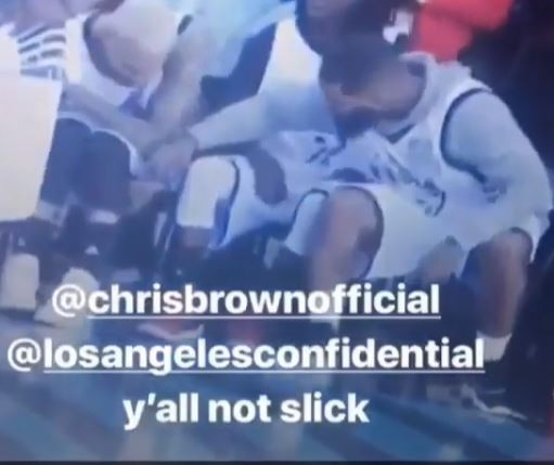 Lol..Chris Brown is caught on camera stylishly passing a blunt to rapper The Game in the middle of NBA All-Stars game (Video)
