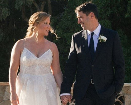 See photos from actress Amy Schumer's wedding to chef Chris Fischer