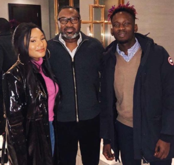 Billionaire businessman, Femi Otedola pictured with his daughter, Temi, and her boyfriend, Mr Eazi