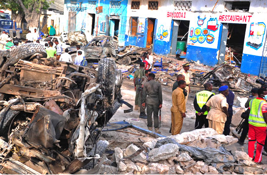 Car bombs by jihadists kill 18 people near the presidential palace in Somalia